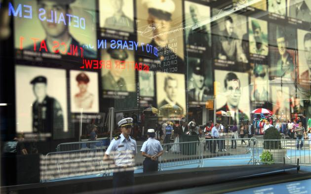 "Photographs of military personnel killed in action in Vietnam are on display in New York's Times Square during a kick off ceremony of the Vietnam Veterans Memorial Fund (VVMF) nationwide ""Call for Pho"