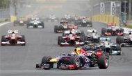 Red Bull Formula One driver Sebastian Vettel of Germany (bottom R) races ahead of the field during the Korean F1 Grand Prix at the Korea International Circuit in Yeongam, October 6, 2013. REUTERS/Kim Hong-Ji