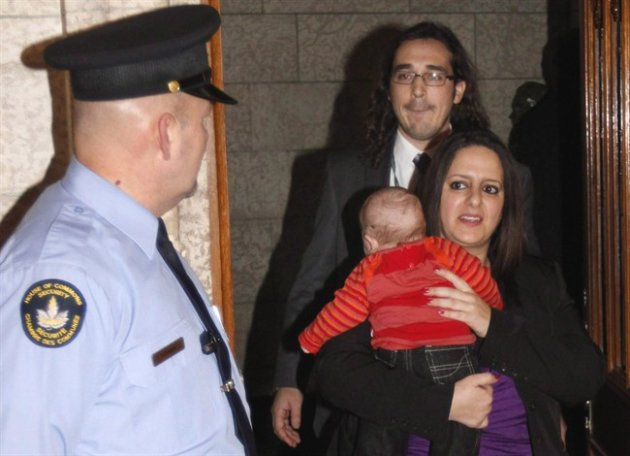 NDP MP Sana Hassainia walks out of the House of Commons with her baby Skander-Jack as she makes her way to meet with reporters on Parliament Hill, in Ottawa on February 8, 2012. A New Democrat MP has quit the party over what she deems leader Tom Mulcair's excessively pro-Israel stance on the current conflict in Gaza. Sana Hassainia, who represents the Montreal-area riding of Vercheres-Les Patriotes, has told Montreal's La Presse she can't accept Mulcair's position and will now sit as an independent. THE CANADIAN PRESS/Fred Chartrand