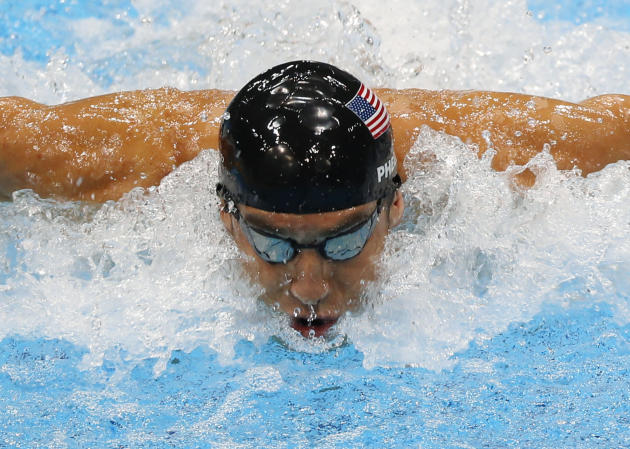 FILE - In this Aug. 4, 2012, file photo, United States' Michael Phelps swims in the men's 4 X 100-meter medley relay at the Aquatics Centre in the Olympic Park during the 2012 Summer Olympics