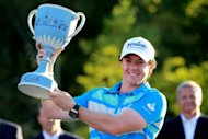 Rory McIlroy of Northern Ireland holds up the trophy after winning the Deutsche Bank Championship at TPC Boston in Norton, Massachusetts