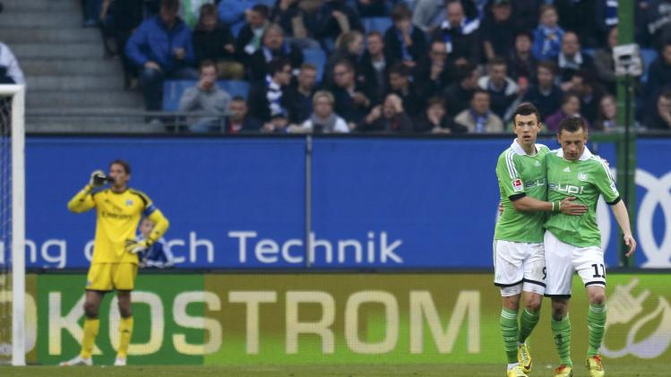 VfL Wolfsburg's Olic is congratulated by team mate Perisic after scoring goal against Hamburger SV during their Bundesliga soccer match in Hamburg
