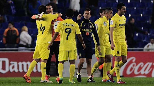 Villarreal goalkeeper Sergio Asenjo is congratulated by his team-mates (AFP)