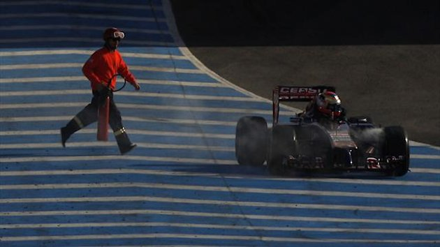 Toro Rosso Formula One driver Jean-Eric Vergne of France gets out of his car after stopping it in the track during pre-season testing at the Jerez racetrack in southern Spain January 30, 2014 (Reuters)