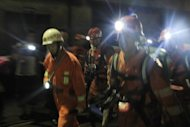 Rescuers head to search for survivers after a gas explosion at a coal mine in Panzhihua, China's Sichuan province, on August 29. TThe death toll from the explosion has risen to 37, with another 10 people still trapped, the official Xinhua news agency said on Friday
