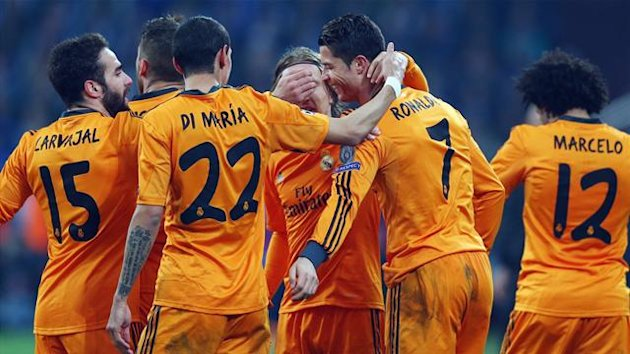 GELSENKIRCHEN, GERMANY - FEBRUARY 26: Cristiano Ronaldo #7 of Madrid celebrates his team's third goal with team mates during the UEFA Champions League Round of 16 first leg match between FC Schalke 04 and Real Madrid at Veltins-Arena on February 26, 2014