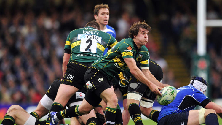 Northampton Saints' English scrum-half Lee Dickson passes the ball during their Heineken Cup Final match against Leinster at the Millennium Stadium, Cardiff, Wales, on May 21, 2011. AFP PHOTO/GLYN KIRK  NOT FOR MARKETING OR ADVERTISING USE/RESTRICTED TO EDITORIAL USE (Photo credit should read GLYN KIRK/AFP/Getty Images)