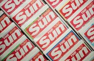 An arrangement of copies of The Sun newspaper front pages, pictured in February. Rupert Murdoch has stepped down as director of a number of companies behind British newspapers The Sun, The Times and The Sunday Times, a News International spokeswoman said on Saturday