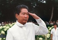 The late Philippines President Ferdinand Marcos saluting during the 84th anniversary of the Philippine Constabulary in Manila in 1985. The Philippine government has auctioned off a prime property once owned by the late dictator for more than $2 million