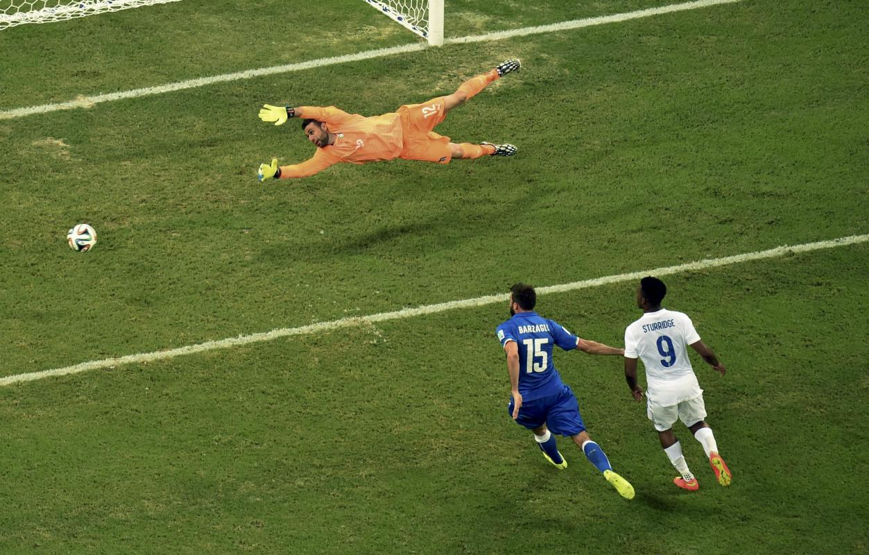 Italy's goalkeeper Sirigu dives for the ball during the 2014 World Cup Group D soccer match between England and Italy at the Amazonia arena in...