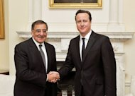 Britain's Prime Minister David Cameron (R) shakes hands with US Secretary of State for Defence Leon Panetta before a meeting at number 10, Downing Street, in central London on January 18, 2013. Islamist hostage-takers at a remote Algerian gas field on Friday demanded a prisoner swap and an end to the French military campaign in Mali, a report said