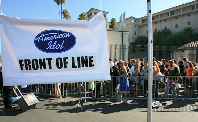 American Idol hopefuls wait in line for the open audition for American Idol Season 6 at the Rose Bowl on August 8, 2006 in Pasadena, California.