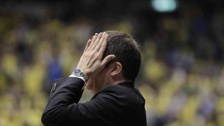 Emporio Armani Milan's Head Coach Luca Banchi holds his hand on his head during the EuroLeague Basketball Group D playoff game against Maccabi Tel Aviv in Tel Aviv, Israel, Wednesday, April 23, 2014