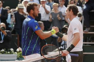 Mathias Bourgue gave Andy Murray all he could handle Wednesday at Roland Garros. (Reuters)