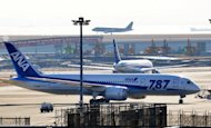 An All Nippon Airways Boeing 787 Dreamliner sits parked at Tokyo's Haneda airport on January 31, 2013. Shares in ANA and battery maker GS Yuasa surged on Thursday after a report that US and Japanese regulators were preparing to give the green light to the resumption of Dreamliner flights