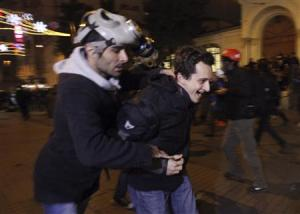 Plain clothes police officers detain a demonstrator during a protest against internet censorship in Istanbul