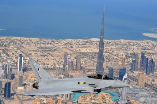 A Typhoon fighter plane flies past Dubai's Burj Khalifa tower during last year's Dubai Airshow. Dubai, famed for its mega-projects before it was hit by the global financial crisis, on Saturday announced a new development to open the world's biggest mall and a park larger than London's Hyde Park