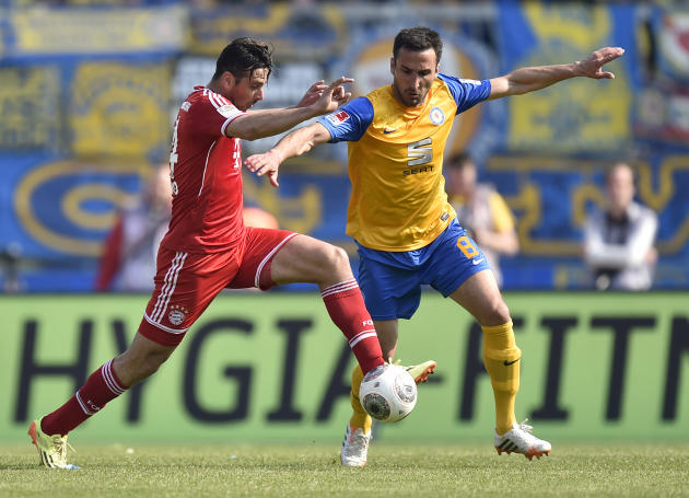 Bayern's Claudio Pizarro of Peru, left, and Braunschweig's Deniz Dogan of Turkey challenge for the ball during the German Bundesliga soccer match between Eintracht Braunschweig and Bayern Muni