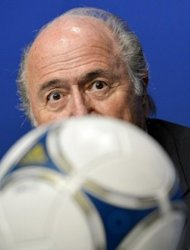 FIFA President Sepp Blatter looks on behind a ball during a press conference at the headquarters of football's world governing body in Zurich. Blatter on Tuesday announced that world football's governing body has adopted a new code of ethics in the wake of a series of damaging corruption scandals