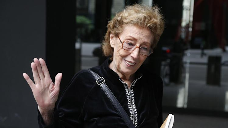 Jacqueline Goldberg departs federal court after a federal jury returned with a finding in Donald Trump's favor in her civil case alleging that the real estate mogul cheated her in a skyscraper condo deal, Thursday, May 23, 2013 in Chicago. (AP Photo/Charles Rex Arbogast)