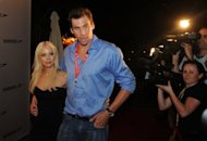 This file photo shows Australian swimmer Grant Hackett and his then wife Candice arriving for a promotional event in Beijing, in 2008. Hackett says he is working to salvage his reputation after trashing his apartment in an alcohol-fuelled rampage last year that saw his wife leave him