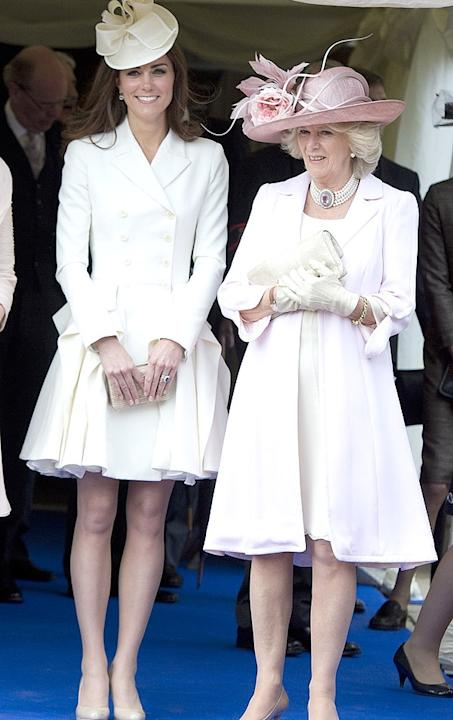 Just over a year later, Kate rewears a Alexander McQueen coat dress with a flirty skirt at the Order of the Garter service in Windsor, England on Monday, June 18. The Duchess originally wore this outf
