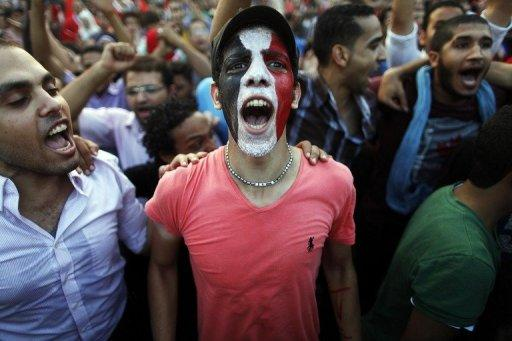 Egyptians shout slogans against President Mohamed Morsi during a rally in Cairo, on July 1, 2013