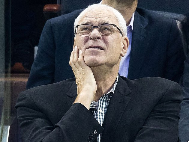 Phil Jackson checks the scoreboard. (Getty Images)