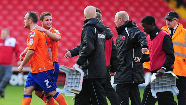 Lee Croft, left, walks away after talking with a ball boy, right, in Saturday's match