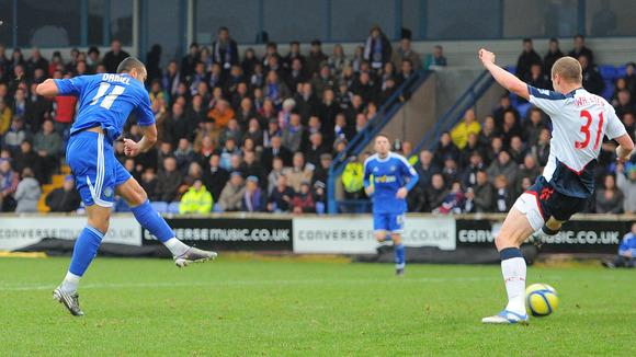 Macclesfield Town's English Midfielder Colin Daniel (L) Scores AFP/Getty Images