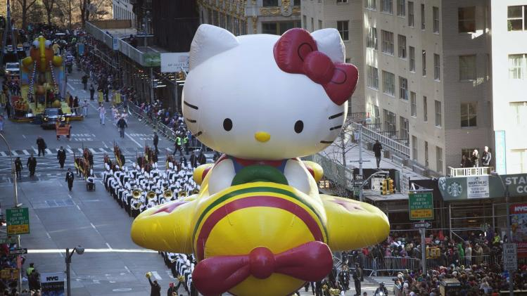 The Hello Kitty balloon float makes its way down 6th Avenue during the 87th Macy's Thanksgiving day parade in New York