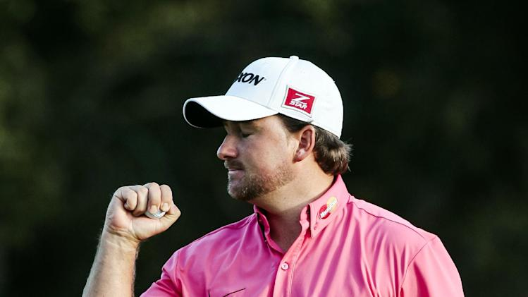 Graeme McDowell celebrates after winning the World Challenge golf tournament at Sherwood Country Club in Thousand Oaks, Calif., Sunday, Dec. 2, 2012. (AP Photo/Bret Hartman)
