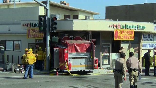 Los Angeles fire engines crash, hit restaurant