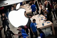 Customers at the new Apple store in Lyon, France. Apple's stock price reversed a losing trend for the day after the release of the earnings figures, jumping more than seven percent to $600.30 a share on the Nasdaq exchange