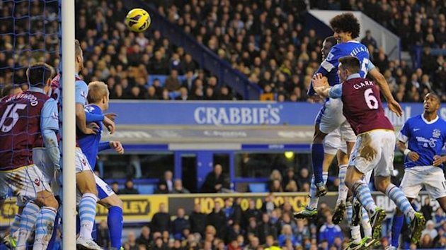 Marouane Fellaini heads a late equaliser for Everton against Aston Villa (AFP)