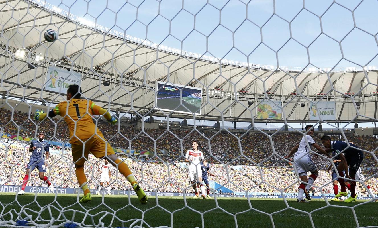 Germany's Mats Hummels scores a goal against France's goalkeeper Hugo Lloris during their 2014 World Cup quarter-finals at the Maracana...