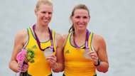 Sarah Tait and Kate Hornsey celebrate their silver in the women's pair