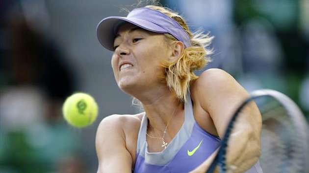 Maria Sharapova of Russia returns a shot against Lucie Safarova of the Czech Republic (Reuters)