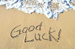 Good luck written in the sand