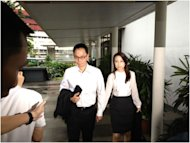 Former CNB chief Ng Boon Gay and his wife arrive at the subordinate courts for his verdict in the sex-for-contracts case. He was found not guilty. (Yahoo! photo)