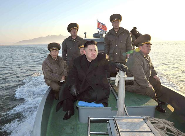 In this March 11, 2013 photo released by the Korean Central News Agency (KCNA) and distributed March 12, 2013 by the Korea News Service, North Korean leader Kim Jong Un rides on a boat, heading for th