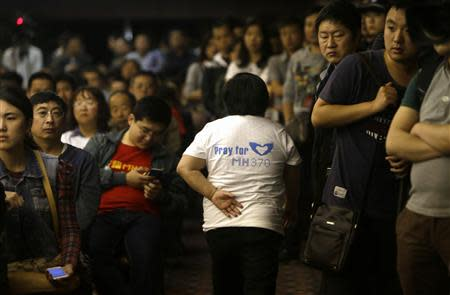 Relative of a passenger aboard Malaysia Airlines flight MH370 leaves a briefing given by Malaysian representatives in Beijing
