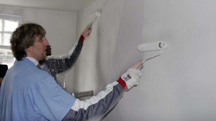 In this Feb. 15, 2008 file photo, Dallas Mavericks basketball star Dirk Nowitzki, of Germany, paints a wall in a home in the Lower 9th ward of New Orleans. This week marks six years since NBA All-Stars ventured into New Orleans neighborhoods devastated by Hurricane Katrina to lend a hand with rebuilding
