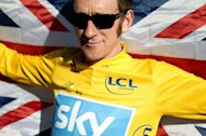 Bradley Wiggins celebrates during the 2012 Tour de France on the famous Paris-Champs-Elysees Avenue, on July 22, 2012. Wiggins led a parade of Olympic champions whose achievements in a remarkable summer of sport in Britain were recognised in the New Year Honours list on Saturday