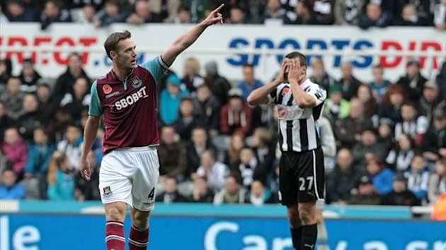 West Ham United's Kevin Nolan (L) celebrates scoring the opening goal as Newcastle United's English defender Steven Taylor (R) reacts on November 11 2012