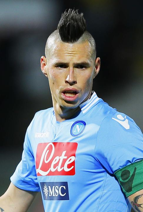 Napoli's Marek Hamsik of Slovakia, follows the game during a Serie A soccer match between Livorno and Napoli, in Leighorn, Italy, Sunday, March 2, 2014