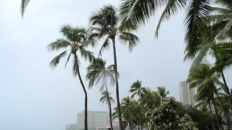Few people visited Waikiki beach in Honolulu on Monday, July 29, 2013 as Tropical Storm Flossie approached Hawaii. The storm faded through the morning, but forecasters were still warning residents and tourists to brace for possible flooding, wind gusts, mudslides and big waves. (AP Photo/Audrey McAvoy)