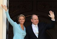 Prince Albert II and Princess Charlene of Monaco greet well-wishers from the balcony after their civil wedding at the Prince's Palace