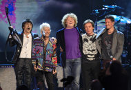 Small Faces/Faces members Ron Wood, left, Ian McLagan, second from left, and Kenney Jones, right, stand with Simply Red lead singer Mick Hucknall, second from right and bassist Conrad Korsch after performing at the Rock and Roll Hall of Fame indiction ceremonies Saturday, April 14, 2012, in Cleveland. Small Faces/Faces were inducted into the Rock Hall. (AP Photo/Tony Dejak)
