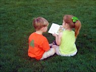Children reading on the lawn